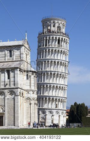 Pisa, Italy - March 31 2019: The Leaning Tower Of Pisa (italian: Torre Pendente Di Pisa) Is The Camp