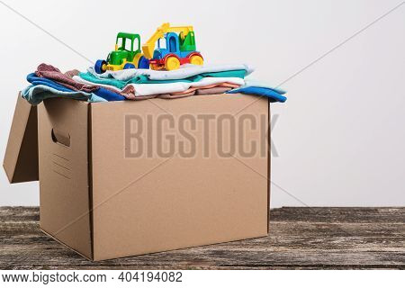 Donation Box With Children's Things And Toys. Donation Box Full With Stuff For Donate. Help Poor.
