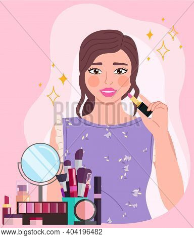 Beautiful Young Girl Makes Look And Does Makeup, Looks After Beauty And Paints Lips On Pink Backgrou