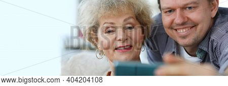 Grandma Shows Her Page On A Social Network. Elderly Woman Shares Her Observations Online
