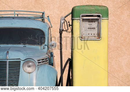 Oingt, France - March 12, 2014: Old And Vintage Gas Pump With A Citroen Car In France