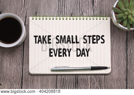 Take Small Steps Every Day, Text Words Typography Written On Book Against Wooden Background, Life An