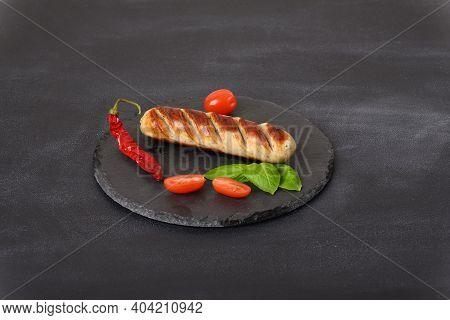 Fried Sausage On The Slate Plate, Close Up.