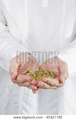 Münzen in Händen