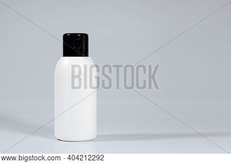 Skincare Cosmetic Bottle On White Gray Background.  Daily Cosmetics. Cosmetics Advertisement Mockup.