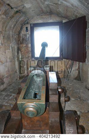 Lisbon, Portugal - July 24, 2011: Cannon In A Window Inside The Belem Tower.