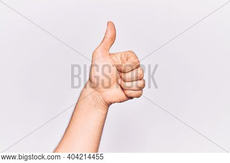 Close up of hand of young caucasian man over isolated background doing successful approval gesture with thumbs up, validation and positive symbol