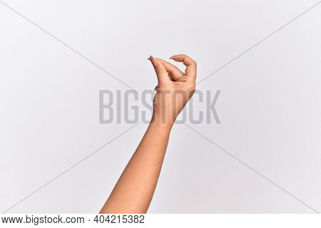 Hand of caucasian young woman snapping fingers for success, easy and click symbol gesture with hand