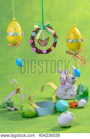 Easter Eggs, Cookie Cutters And Funny Bunnies. Concept Of An Easter Holiday With A Copy Space.