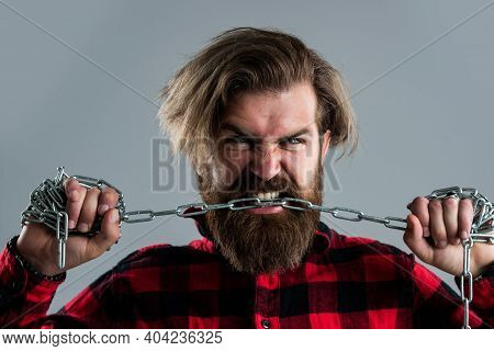 Brutal Bearded Man Biting Steel Chain With Strong Teeth, Correction Of Bite