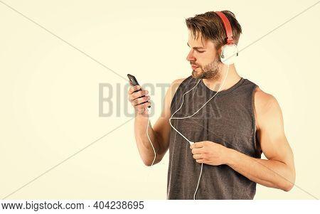 Man Handsome Unshaven Hipster Listening Audio File Using Headphones Gadget. Modern Earphones Concept