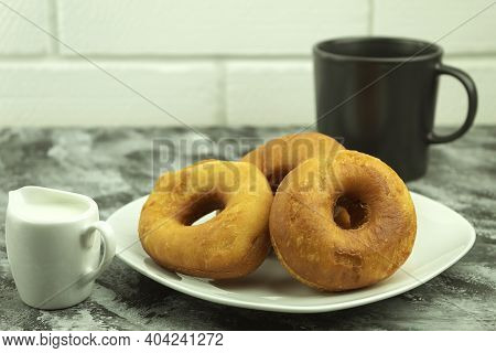 Homemade Round Donuts On A White Plate. Homemade Cakes With Space For Text. Homemade Donut Recipe