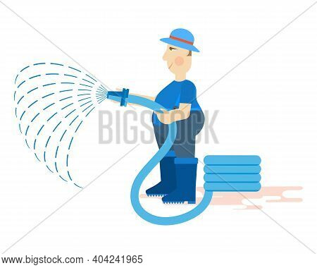 A Male Gardener In Overalls, Rubber Boots And Gloves Holds A Watering Hose. Work On A Personal Plot.
