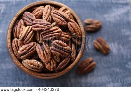 Pecan Nut Close-up In A Round Wooden Cup On A Black Shabby Board .nuts And Seeds. .healthy Fats.heap