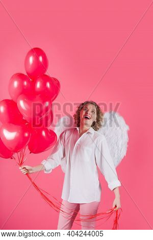 Woman Cupid. Valentine Day Advertising. Cupid Angel Woman With Balloons. Cupid In Valentine Day. Wom