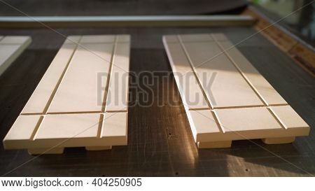 A Stack Of Wooden Facades Is Waiting For Processing In The Carpentry Industry. Wooden Facade Of Furn
