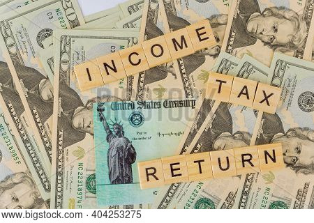 Stimulus Economic Tax Return Check Of American Blank Tax Forms 1040 On Dollar Bill With Income Tax R
