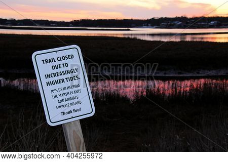 Trail Closed Sign On A Marshy Saltwater Cove At Sunrise.