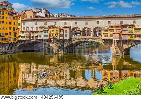 Florence, Italy - May, 2009: The Old Bridge, Or Ponte Vecchio, Over The River Arno In Florence, Ital