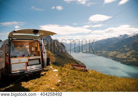 Vanlife - Camping Van On A Mountain In Switzerland