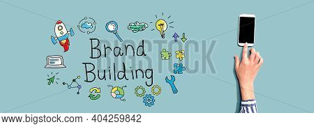 Brand Building With Person Using A Smartphone