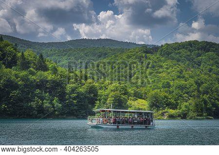 Plitvicka Jezera, Croatia, July 2019 Ferry With Tourists On Turquoise Coloured Lake. Plitvice Lakes