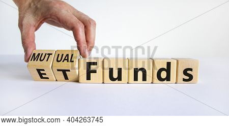Mutual Funds Vs Etf Symbol. Businessman Turns A Cube And Changes Words 'etf, Exchange-traded Fund' T