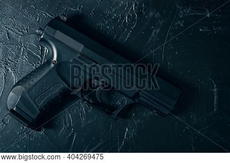 Pistol On Green Concrete Texture Table. Ammunition Of Law Enforcement Agencies. Handgun For Cop. Fir