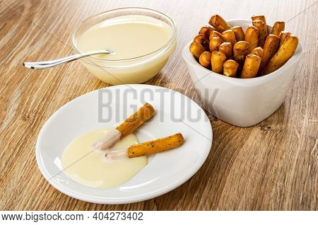 Teaspoon, Condensed Milk In Glass Bowl, Breadsticks With Poppy In Bowl, Breadsticks With Condensed M