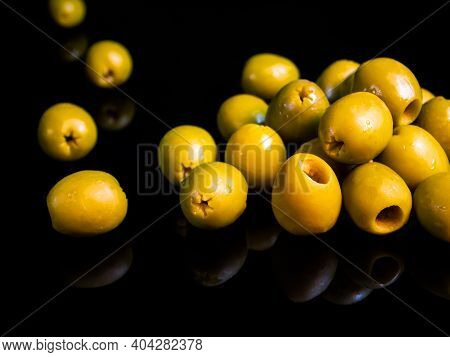 Fruits Of Green Olives Berries On A Black Background. Olive Berry. Canned Olives. Green Olive. Food