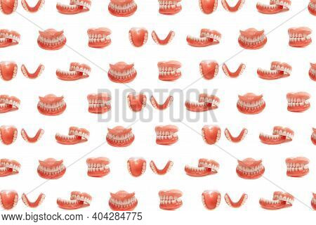 Set Of Dentures On A White Background. Full Removable Plastic Denture Of The Jaws. Isolate On White