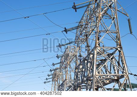 High Voltage Electric Pole, Wiring Electric Power On Steel Tower. Electric Power Transmission Infras