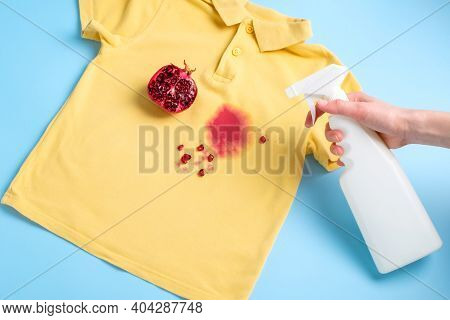 Female Hand Holding A Stain Remover To Remove A Dirty Stain From On Clothes. Daily Life Dirty Stain