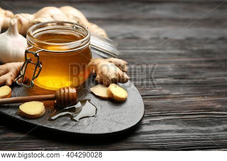 Ginger And Honey On Black Wooden Table, Space For Text. Natural Cold Remedies