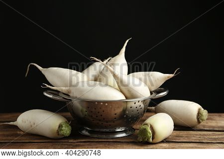 Colander With White Turnips On Wooden Table