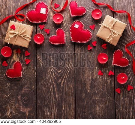 Red Hearts, Gift Boxes And Candles On Wooden Boards. Empty Space For Congratulations On Valentine's