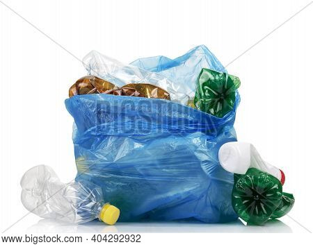 Garbage Bag Full Of Plastic Waste, Eggplants And Bottles Isolated On White Background