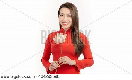 Beautiful Vietnamese Girls Dressed Traditional Ao Dai Red Dress. Vietnamese Girl Holding A Lotus Flo