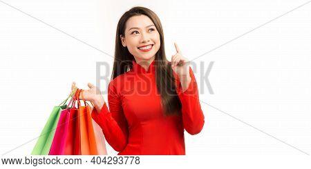 Happy Asian Woman Wearing A Ao Dai Dress Traditional With Shopping Bags Enjoying In Shopping In Luna