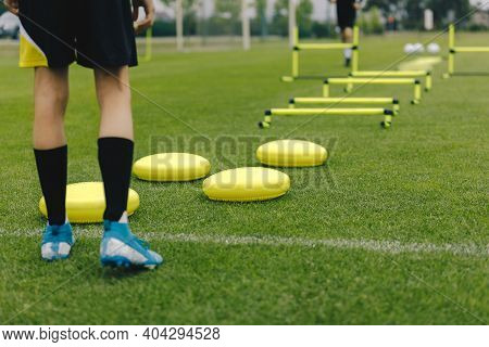 Soccer Training Equipment. Footballer Ready To Practice. Player Is Sportswear And Soccer Cleats. Spo