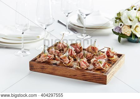 Outdoor Catering Banquet In Summer. Table With Snacks And Canapes At A Summer Banquet