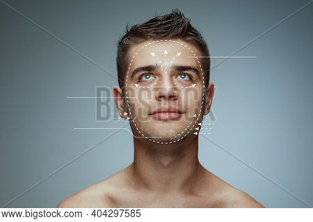 Beautiful Male Face With Lifting Up Arrows Isolated On Grey Background. Concept Of Bodycare, Cosmeti