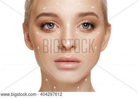 Beautiful Female Face With Lifting Up Arrows Isolated On White Background. Concept Of Bodycare, Cosm