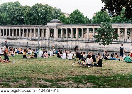 Berlin, Germany, July 30, 2019: People Enjoying Sitting On Spree Riverside