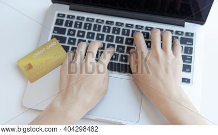 Online product purchase, Businesswoman use laptop register via credit cards to make online purchases