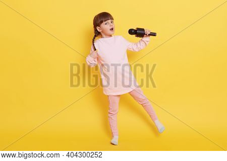 Caucasian Little Girl Singing With Microphone And Dancing, Cute Small Artist Performing Isolated Ove