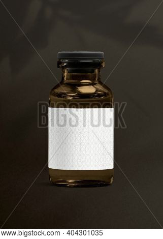 Vitamin injection amber glass bottle with luxurious white label for health and wellness product packaging