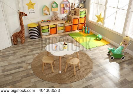 Stylish Playroom Interior With Modern Furniture And Soft Toys, Above View