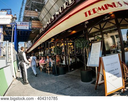 Paris, France - May 20, 2018: Ultra Wide-angle View Of French Street With Cafe Terminus Nord Near Ga