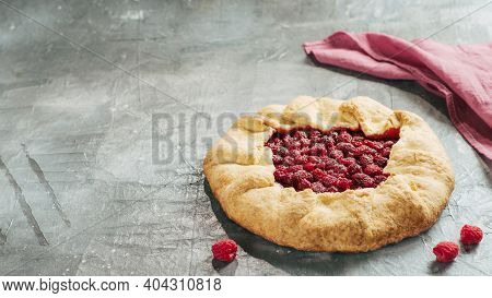 Perfect Raspberry Galette. Delicious Rustic Homemade Tart With Frozen Or Fresh Raspberries On Gray B